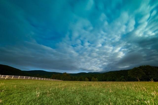 mountains-night-clouds-grass